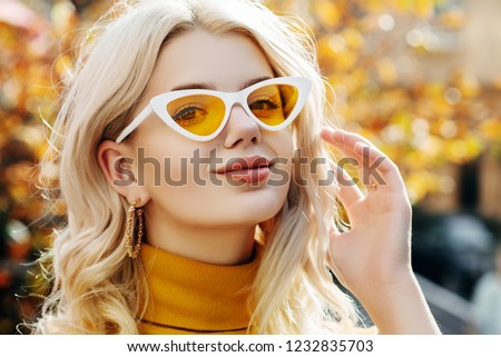 close up of blonde woman with yellow sunglasses and headscarf stock photo © feedough