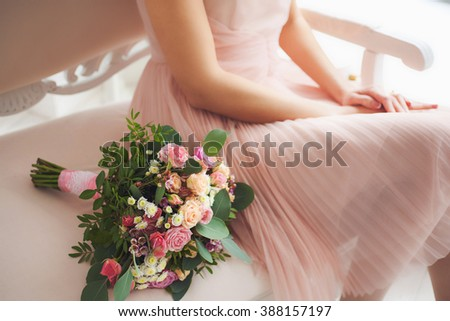 In the hand of a stylish girl a pink rose, a girl's legs in jeans and black high-heeled shoes around Stock photo © artjazz