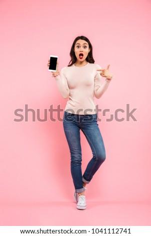full length portrait of elegant brunette woman 20s wearing red d stock photo © deandrobot