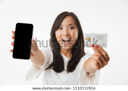 Blurry photo of smiling woman with long brown hair holding cell  Stock photo © deandrobot