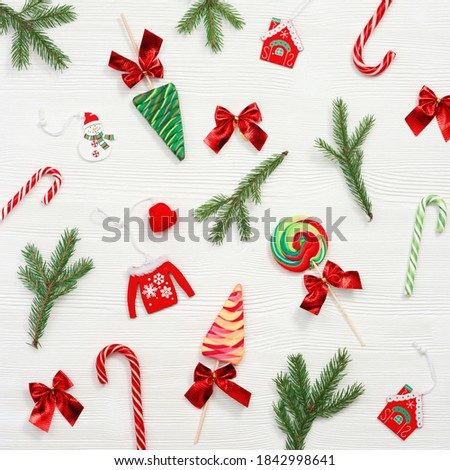 Winter stripe branch with bow and ribbon, sweet candy and snowflakes on blue background with light e stock photo © heliburcka