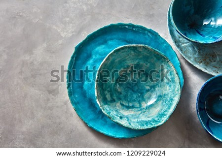 Clay handcraft empty gray bowls, covered with glazed a gray wooden background with copy space. Flat  Stock photo © artjazz
