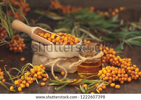 Stock photo: Natural, organic sea-buckthorn berry in linen bag and sea buckth