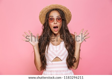 Photo of lovely woman 20s wearing sunglasses and straw hat yelli Stock photo © deandrobot