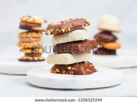 Luxury belgian chocolate and biscuit cookies selection on marble coasters and white kitchen table ba Stock photo © DenisMArt