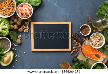 Blank chalkboard for text. With raw seafood salmon and vegetables and spices on stone kitchen backgr stock photo © DenisMArt