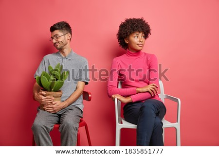 Unhappy Mixed Race Couple Sitting Facing Away From Each Other on Stock photo © feverpitch