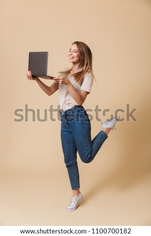 Full length portrait of joyous blond woman 20s smiling at camera Stock photo © deandrobot
