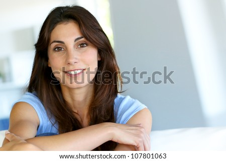Image of pretty woman 30s with long dark hair looking and pointi Stock photo © deandrobot