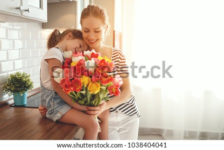 A Happy mother's day. Child daughter congratulates moms and gives her a gift Stock photo © Lopolo