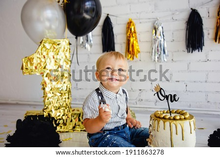 One year old boy is celebrating his first birthday and eating fe Stock photo © Stasia04