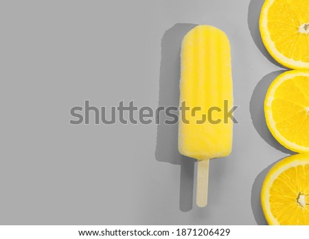Waffle cone with melted ice cream in a color of the year 2019 Living Coral pantone on a gray backgro Stock photo © artjazz