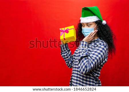 Image of excited woman 20s wearing red sweatshirt holding laptop Stock photo © deandrobot