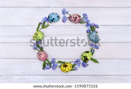 Green decorative Easter quail eggs wreath on yellow wooden table Stock photo © dash