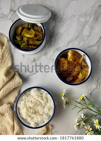 Lifestyle food. A dish consisting of rice, fried fish with wood mushrooms and different kinds of sau Stock photo © galitskaya