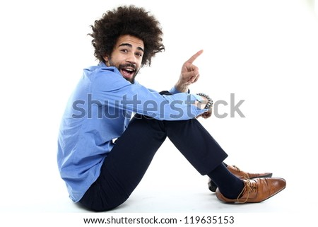 Full length image of Smiling curly business man with briefcase Stock photo © deandrobot