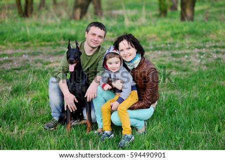 család · anya · apa · kicsi · fiú · doberman - stock fotó © ElenaBatkova
