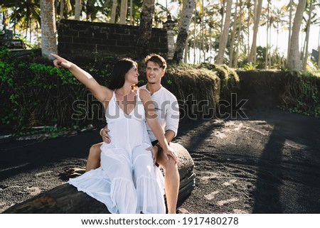 Young pregnant woman in white dress sitting on the beach near blue sea and breathing. Summer vacatio Stock photo © ElenaBatkova