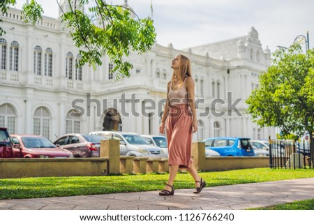 Woman on background of City Hall in George Town - Penang, Malaysia. British built historical buildin Stock photo © galitskaya