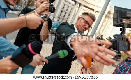 reporter hands holding microphone while man refusing interview stock photo © andreypopov