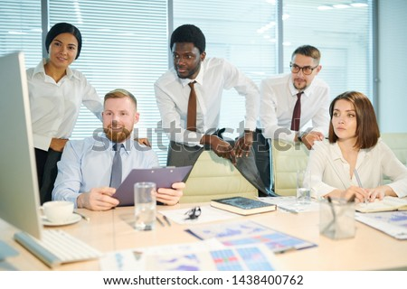 Multicultural brokers in formalwear taking part in online conference Stock photo © pressmaster
