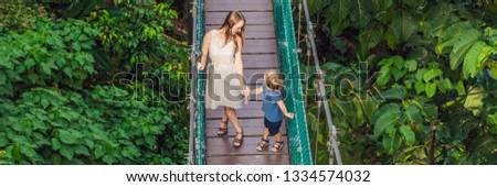 mother and son at the suspension bridge in kuala lumpur malaysia banner long format photo stock © galitskaya