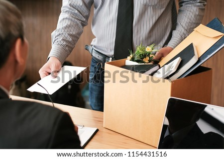 Image of businessman hand sending a resignation letter to execut Stock photo © Freedomz