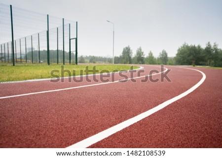 White dividing line making up race tracks in diminishing perspective Stock photo © pressmaster