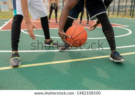 One of young intercultural basketball players taking away the ball Stock photo © pressmaster