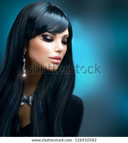 Beautiful woman with diamond necklace. Young beauty model with diamond pendant and earrings. Jewelle stock photo © serdechny
