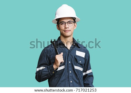 Young man in a yellow work uniform, glasses and helmet in industrial environment,oil Platform or liq stock photo © galitskaya