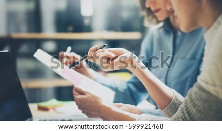 Business Colleague Discussing Project On Tablet In The Elevator Stock photo © AndreyPopov