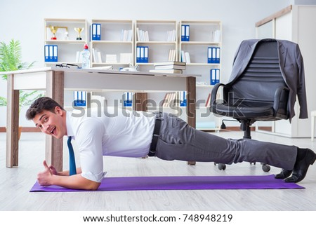businessman doing pushups at work stock photo © andreypopov