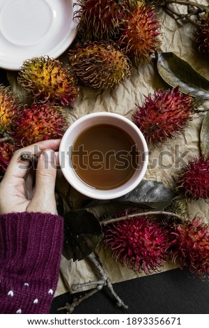 Girl holding mug with hot drink surrounded by traditional xmas food and symbols Stock photo © pressmaster