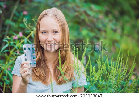 Young man holds in her hand allergy tablets because of an allergy to ragweed Stock photo © galitskaya