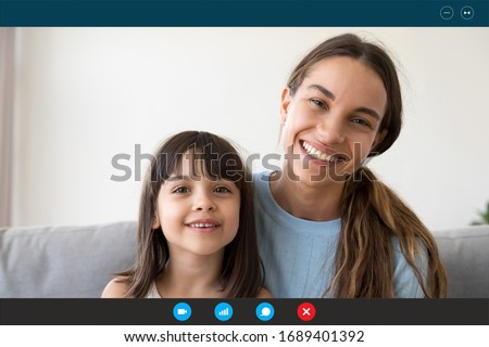 Indoor shot of happy mom and daughter have pleasant talk together, have yoga practice, meditate on s Stock photo © vkstudio