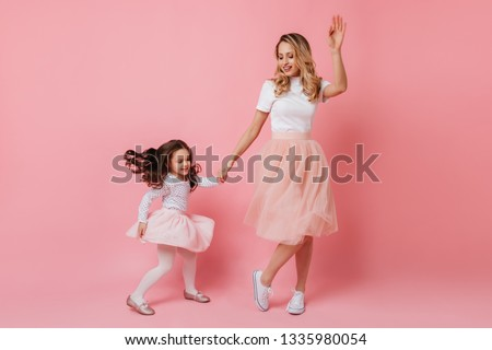 An adult woman a beautiful mother in a pink fluffy dress holds her son of Asian appearance in her ar Stock photo © ElenaBatkova