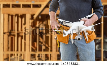 Construction Worker and Drone Pilot With Toolbelt Holding Drone  Stock photo © feverpitch