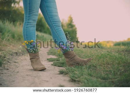 Western style image of cowgirl's legs in jeans and boots on dese Stock photo © Lopolo