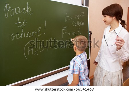 Two clever elementary schoolkids studying chemistry with microscope Stock photo © pressmaster