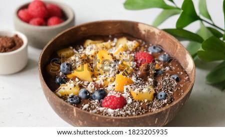 Various healthy fresh smoothies or yogurts in bowls. With strawberries, kiwi, chia, blackberries Stock photo © dash