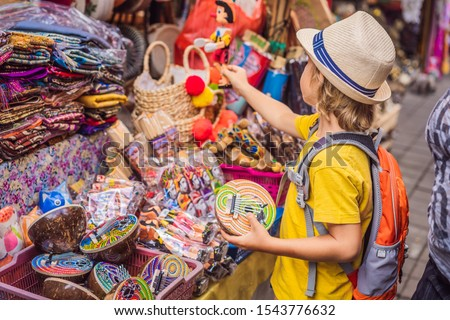 Boy at a market in Ubud, Bali. Typical souvenir shop selling souvenirs and handicrafts of Bali at th Stock photo © galitskaya