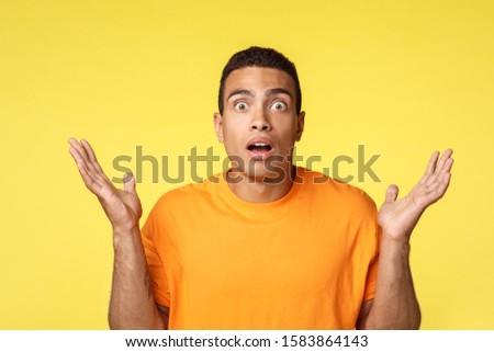 Csalódott fiatalember elveszett fogadás játék kezek Stock fotó © benzoix