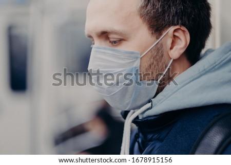 Grave hombre trabajo subterráneo virus máscara Foto stock © vkstudio
