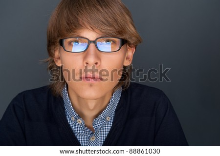Portrait of young man with smart and wise look. Looking at camer Stock photo © HASLOO