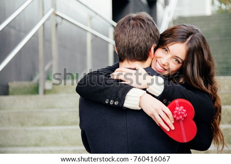 beautiful happy woman holding red heart shaped box on her ears stock photo © rob_stark