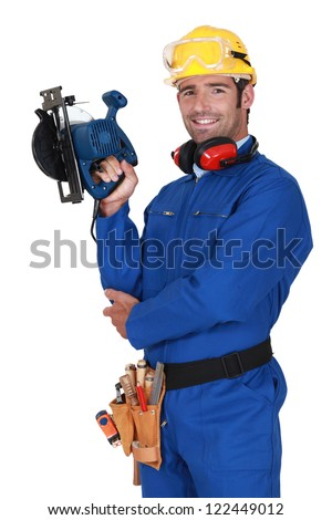young blue collar with protective equipment and sander machine Stock photo © photography33