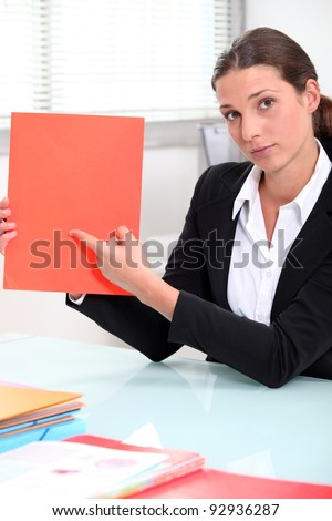 Brunette businesswoman pointing to a file left blank for your image Stock photo © photography33