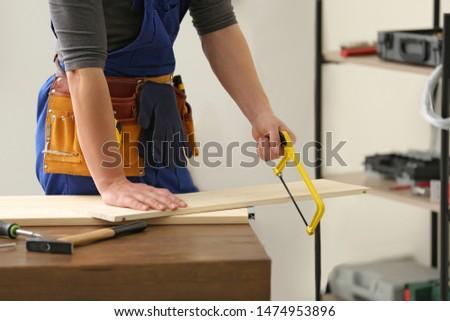 Man using hand-saw Stock photo © photography33
