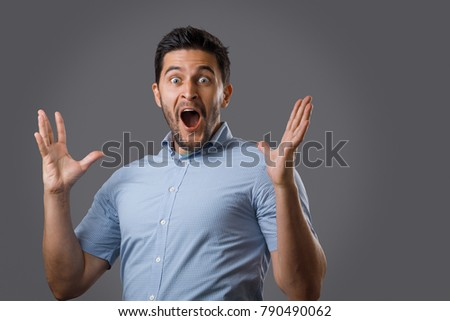 Portrait of a surprised young businessman against a white background Stock photo © wavebreak_media